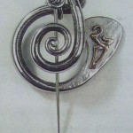 Penannular brooch, forged stainless steel and bronze