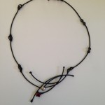 Neckpiece ...Welded Steel and 23K Gold leaf with 6mm synthetic Ruby and Fine silcer