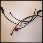 Neckpiece ...Welded Steel and 23K Gold leaf with 6mm synthetic Ruby and Fine silver