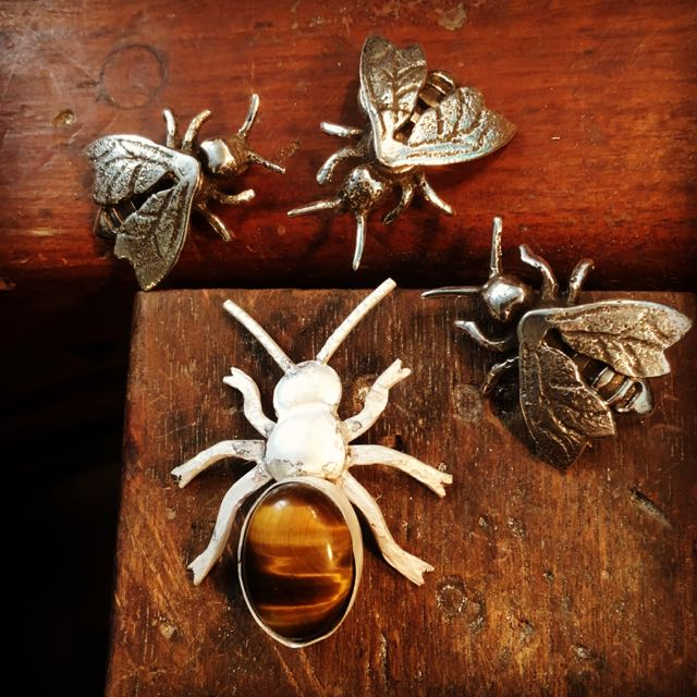 Honey Bees. The unassembled master with Tigereye and the sterling silver castings made from it (work in progress)