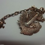 Cuttlefish cast anchor brooch, cast bronze heart with steel chain