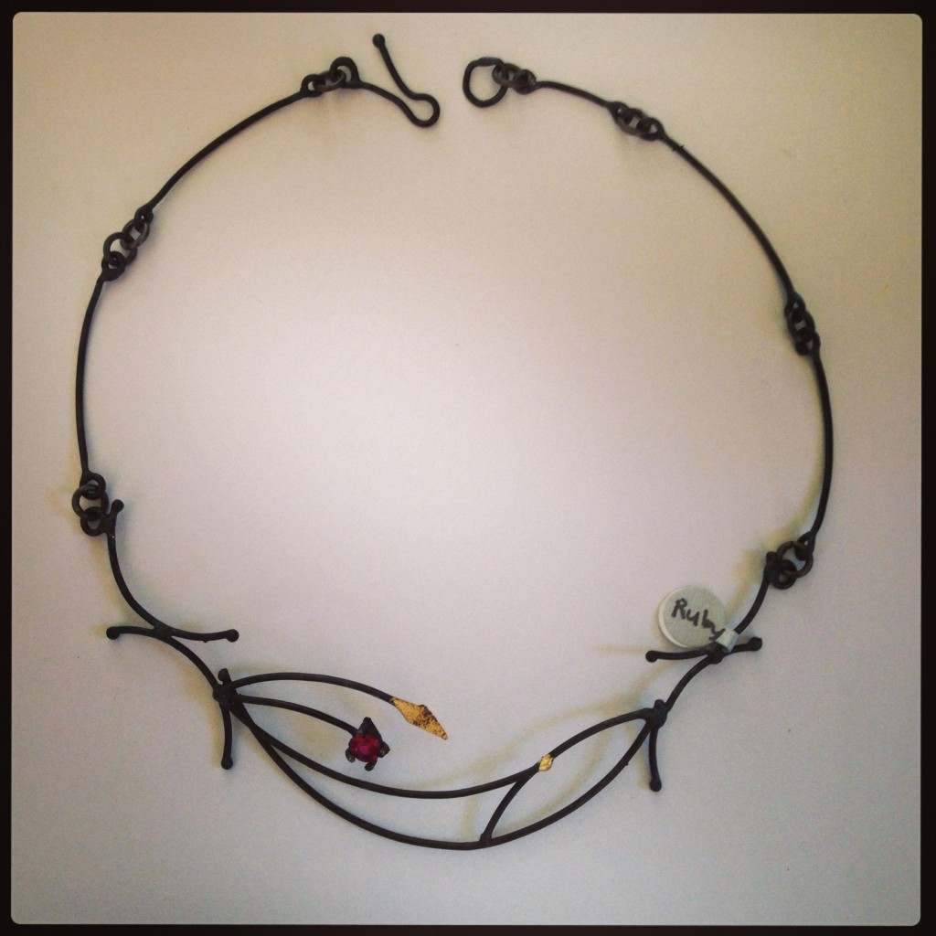 Neckpiece ...Welded Steel and 23K Gold leaf with 6mm synthetic Ruby